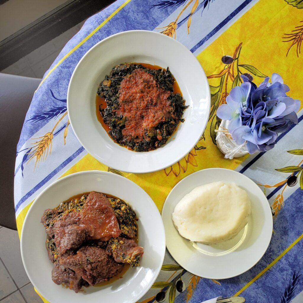 Nigerian efo riro and poundo yam at Mummy's Afro-Caribbean Kitchen in Toronto. From the creators of Toronto Global Eats Challenge & Food Tour.